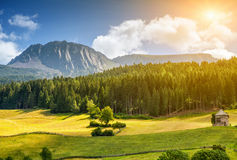 Colorful Alpine scenery with sun setting down Stock Image