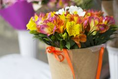 Colorful Alstroemeria flowers. A large bouquet of multi-colored alstroemerias in the flower shop are sold in the form of a gift bo. X. The farmers market. Close royalty free stock photos
