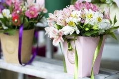 Colorful Alstroemeria flowers. A large bouquet of multi-colored alstroemerias in the flower shop are sold in the form of a gift bo. X. The farmer`s market. Close royalty free stock image