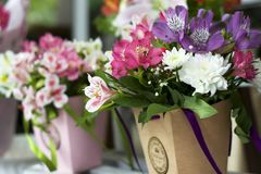 Colorful Alstroemeria flowers. A large bouquet of multi-colored alstroemerias in the flower shop are sold in the form of a gift bo. X. The farmers market. Close stock image
