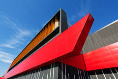 Colorful aluminum facade on large shopping mall. Details of aluminum facade with colorful red and orange panels on large shopping mall Royalty Free Stock Photos