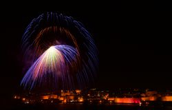 Colorful amazing fireworks in Valletta, Malta with city and reflection background, city silhouette, Malta fireworks festival,4 Jul Royalty Free Stock Images