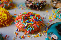 Colorful american donuts with the sweet crumbs Stock Photo