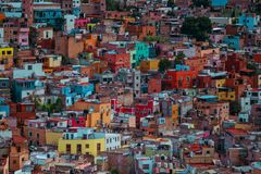 Colorful ancient American cathedral architecture in crowd, Guanajuato, Mexico. Colorful colonial architecture building in hill, which was built in silver mining royalty free stock photography