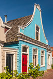 Colorful ancient blue wooden house in The Netherlands Royalty Free Stock Images