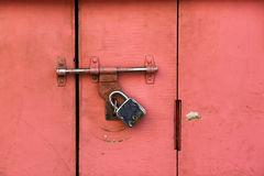 Colorful ancient locked door. Colorful ancient door locked by a very old style door lock Stock Image