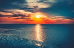 Free Colorful And Dramatic Sunset Sky Ocean Background Stock Image - 102565211