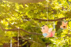 Colorful Angel ceramic doll hanging in the garden. Stock Photos