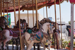 Colorful animal carousel carnival ride Stock Photos