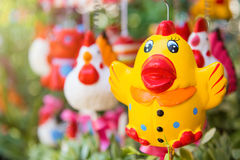 Colorful animal ceramic doll hanging in the garden. Stock Image