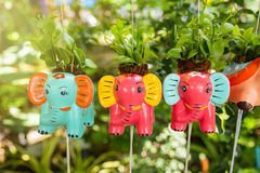 Colorful animal ceramic doll hanging in the garden. Royalty Free Stock Image