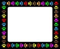 Colorful animal paw prints black frame. Royalty Free Stock Photos