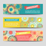 Colorful anniversary banners with fireworks Stock Images