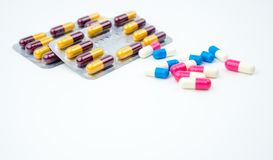 Colorful of antibiotic capsules pills on white background with copy space. Drug resistance, antibiotic drug use with reasonable, h Stock Image