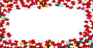 Colorful of antibiotics capsule pills rectangle frame. On white background with copy space. Drug resistance concept. Antibiotics drug use with reasonable and Royalty Free Stock Photo