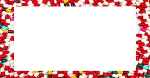 Colorful of antibiotics capsule pills rectangle frame on white. Background with copy space. Drug resistance concept. Antibiotics drug use with reasonable and Stock Photos