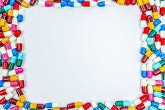 Colorful of antibiotics capsule pills rectangle frame on white. Background with copy space. Drug resistance concept. Antibiotics drug use with reasonable and Stock Photo