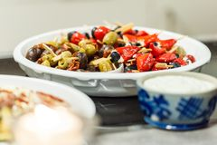 Colorful antipasti bowl on table stock photos