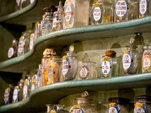 Colorful antique flasks on wooden shelf. Colorful antique chemical flasks on a shelf, used by German chemists in the late 17th century stock images