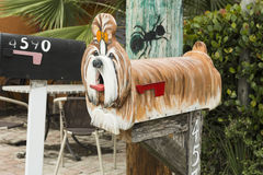 Colorful antique mailboxes on Matlacha in Pinie Island, Fort Myers, NM. Colorful Wooden mailbox in the shape of a poodle on Matlacha in Pinie Island, Fort Myers Stock Photography