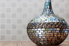 Colorful antique mirror design vase on the wood table with soft background. Object Royalty Free Stock Photo