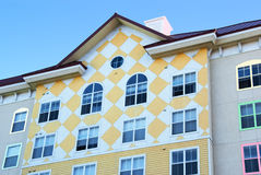 Colorful Apartment Building. Apartment building with a colorful checkerboard yellow pattern royalty free stock photo
