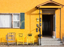 Colorful apartment building. Apartment building entrance details, complete with shopping carts stock photography