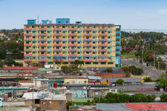 Colorful apartment building. Modern apartment building and simple homes in Varadero, Cuba royalty free stock photography