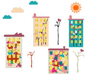 Colorful apartment buildings with drawings. On white background Royalty Free Stock Photography