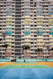 Colorful apartment buildings, Hong Kong. View on colorful apartment buildings and court with palms in Hong Kong Stock Images