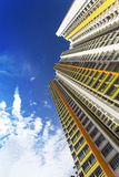 Colorful Apartment. An extreme low angle shot of a new colorful high rise apartment against the sky Stock Photos