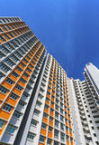 Colorful Apartment. A vertical low angle shot of a new colorful high rise apartment against the sky Stock Photos