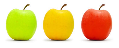 Colorful apples. Three multi-colored apples isolated on white Stock Photography