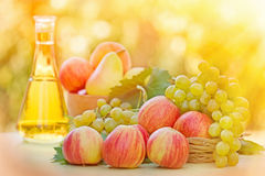 Colorful apples, white grapes and white wine Royalty Free Stock Photos