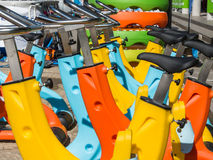 Colorful Aquatic bikes in Line, Designated for Swimming Pool Royalty Free Stock Photos