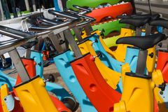 Colorful Aquatic bikes in Line, Designated for Swimming Pool Stock Photography