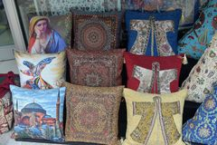 Pillows, turkish market. Colorful arabic pillows and carpets Royalty Free Stock Photos