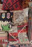 Pillows, turkish market. Colorful arabic pillows and carpets Royalty Free Stock Images