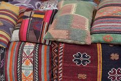Pillows, turkish market. Colorful arabic pillows and carpets Royalty Free Stock Photo