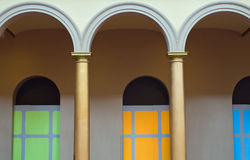 Colorful arches. A view of symmetrical arches and colorful painted panels in the background, found at the National Building Museum, Washington, DC Royalty Free Stock Images