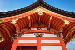 Colorful Architectural roof eaves detail at Kiyomizu-dera Buddhist Temple, Kyoto, Japan. Colorful Architectural roof eaves detail against the sky at Kyo-Do Sutra royalty free stock photo
