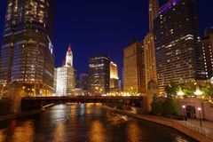 Colorful architecture of Chicago along Chicago River at night. Chicago, Illinois, USA. stock photo