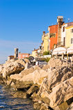 Colorful architecture at harbor of Piran, small coastal town in Istria Royalty Free Stock Images