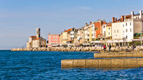 Colorful architecture at harbor of Piran, small coastal town in Istria Stock Image