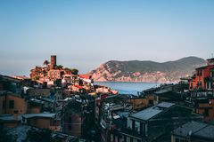Famous view of the Vernazza old town Italy Cinque terre in the early morning sunrise view, colorful traditional building houses an royalty free stock photo