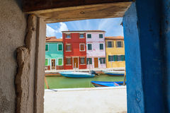 The colorful architecture of the sunny Island of Burano, a tourist attraction near Venice, Italy, which shows the harmony, joyful Stock Photos