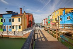 The colorful architecture of the sunny Island of Burano, a tourist attraction near Venezia Italy, which shows the harmony, joyful. The colorful architecture of Stock Photography