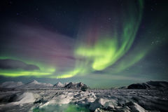Colorful Arctic winter landscape - Frozen fjord & Northern Lights stock image