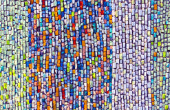 Colorful argile mosaic on the wall. Vertical colorful argile mosaic on the wall Royalty Free Stock Photos