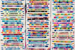 Colorful arm bracelets with embroidered names Stock Photography